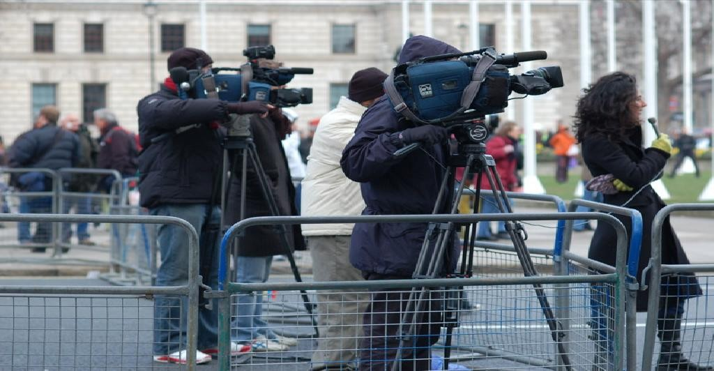 some tv cameras and maybe a journalist